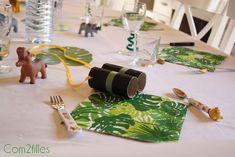 Une décoration de table pour un anniversaire d'enfant sur le thème de la jungle.