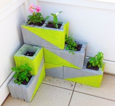 10 Awesome Upcycled Herb Garden Ideas Neon Cinder Block Garden This creative cinder block garden . Diy Concrete Planters, Herb Planters, Concrete Blocks, Cement Garden, Wall Planters, Planter Ideas, Outdoor Planters, Planter Pots, Outdoor Decor