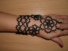 This bracelet is designed to a romantic woman that want to stand out from the crowd.   Bracelet is made with shuttle tatting technique from cotton thread in black color.  Loop made with knot slides easily into your finger.It fits average size hand.  This sale is for one bracelet, but if you need pair please contact me.