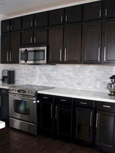 Kitchen Backsplash with Dark Cabinets. Kitchen Backsplash with Dark Cabinets. Contemporary Kitchen Backsplash Ideas with Dark Cabinets Elegant Kitchens, Black Kitchens, Beautiful Kitchens, Home Kitchens, Backsplash With Dark Cabinets, New Kitchen Cabinets, Kitchen Backsplash, Backsplash Ideas, Backsplash Design