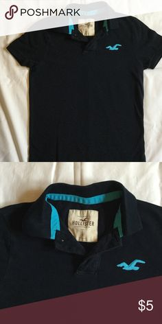 Hollister Polo Shirt A Hollister Polo Shirt size Small with blue logo on upper left. This is a nice used top, and is still a decent shade of black despite being used. No stains, rips or tears. Hollister Tops Tees - Short Sleeve