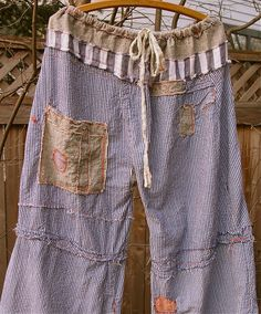 By eanie meany  karna erickson on Flickr.  Luv these! Made from bits of other garments.