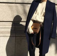 Navy blue jacket and pants, white sweater - classic color combination, plus Celine box bag to lux it all up