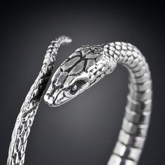 whimsical vintage scarf ring in sterling from Tiffany & Co. This friendly viper will hold your scarf stylishly around your neck