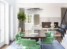 Sleek green chairs surround the table in the dining room of a traditional-meets-modern home in Northern California. | archdigest.com