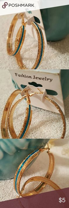 BOGO SALE! Gold hoop earrings Gold hoops with blue accent stripe. 2.5inches diameter. Very light weight. Never worn. Buy one piece of jewelry and get a 2nd for just $1! Just add to a bundle and make offer. Jewelry Earrings