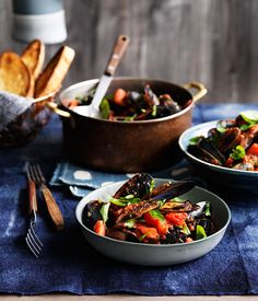 Mussels in Chili, Garlic, and White Wine Tomato Sauce with Italian Parsley, Basil, and Toasted Ciabatta