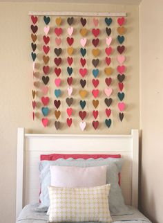 I wonder how this would look if it was black white gray and red to match out bedroom.... DIY Paper Heart Wall Art by Honeybee Vintage