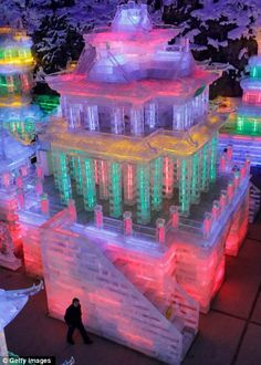 Beijing's multi-colored ice city... reminds me of My Ice Castle