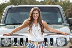Senior pictures, in a field with a car. Good way to incorporate the seniors car, especially if it's unique to them