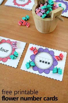 Free printable flower number cards-great for using with manipulatives to practice counting, comparing, addition and more. Use with your spring preschool theme