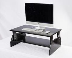 If you or others in your office are ready to get off your butts and on your feet at work, we have a solution for you! These Stand-up Desk Converters are available in 3 finishes to match the decor at your office (Black, Natural, and Combo). http://www.standingdesktopper.com/ #standingdesk #standupdesk