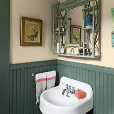 Beadboard and a salvaged sink reinforce the cottage spirit in this small bathroom.