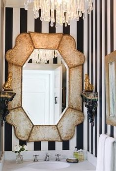 stripes, mirror.  Ps, everyone should have a chandelier in their bathroom.