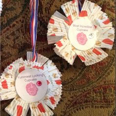 Cupcake war awards - ordered cheap plastic from oriental trading and glued cup cake holders to front and back of metal. Printed award sayings to each metal and embellished with a rhinestone. Each party girl designed  cupcake won an award bestowed by the birthday girl