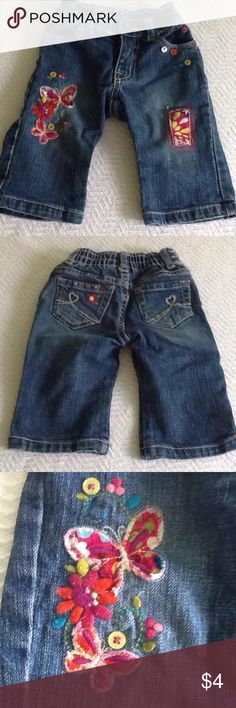 Children's place decorated jeans Jeans have a slightly distressed look with button/butterfly details. Elastic waist in the back makes these a comfy everyday Jean. Children's Place Dresses