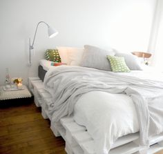 pallets painted white become clean and simple in this bedroom.