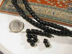 Vintage Black Masai Beads  25 pcs  by ByRobertaSupplies on Etsy, $5.85