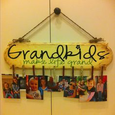 DIY gift for grandparents for under $20! Vinyl lettering from etsy, painted wooden sign, clothespins with scrapbook paper mod-podged to decorate, and twine to hang it.