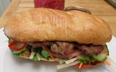 Bahn Mi Sandwich - a Vietnamese classic sandwich with pickled onions and carrots, and slices of fresh cucumber and cilantro on a French roll.