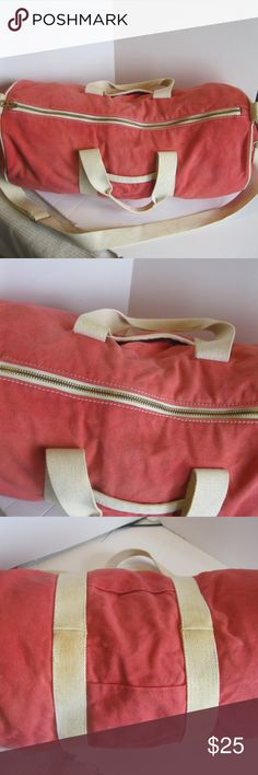 "J. Crew Pink Canvas Duffel Bag - 20"" x 9"" Very cute J. Crew Pink Duffel Bag. Beige straps/accents. 100% cotton canvas. Measures 20"" long, and 9"" in diameter. Bag has shoulder strap. Style #92453.  Bag in good shape - no holes, although a small grey mark on bottom and some fading on bottom straps.   Note: bag is not labeled J. Crew but J. Crew listing came up when I searched the style #. J. Crew Bags Travel Bags"