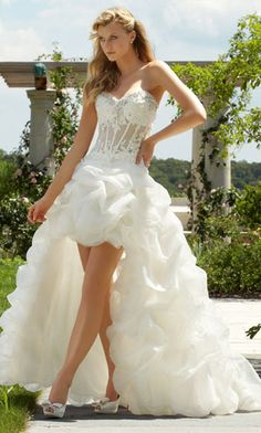 High low wedding dress. Love the corset, mid-section part of this dress! The bottom is atrocious.