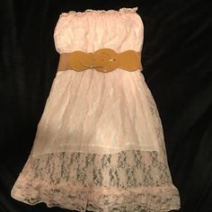 """Soft light pink lace strapless halter w/ tan belt Soft light pink lace strapless halter w/ tan belt. This is lined and sewn in. Can be worn with leggings or jeans. Very cute. No Tag. This fits a size 2-4 adult. It fits me I am 127 5'8"""" 34D. It has a good 6 inches of stretch and could go up to fit a larger size. Tops"""