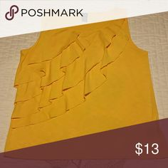 Ruffle front tank This tank is gorgeous on. You can wear it with a cute pair of jeans and sandles or under your favorite blazer for a more sophisticated look. Very comfortable. Yellow in color. Rafaella Tops Tank Tops