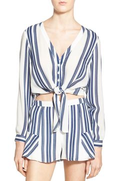 Loving this easygoing blouse with a bit of drape and a cropped silhouette. The tie in front adds just a bit of sass.