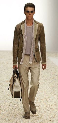 Ermenegildo Zegna   From cool colours to tailored cuts, Zegna's styles for the next warm weather season is classic. Khakis are paired with suede coats and grey T-shirts - with just a touch of Bohemian in a narrow scarf.