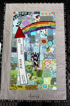 House and rainbow quilt