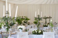 Flowers and candle stick holders on the tables at Trevenna barns