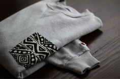 Buy a Hanes sweatshirt & create a pocket in a pattern. this is a must