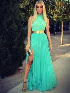 Gorgeous magic mint long maxi dress with golden belt and golden clutch and cute pumps