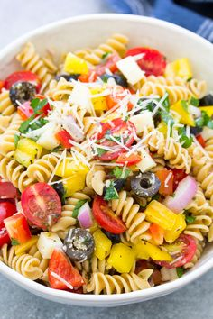 The Best Italian Pasta Salad Recipe! This easy cold pasta salad is loaded with fresh veggies, olives and cheese. Made with Italian dressing (use store bought or my zesty homemade dressing). One of our favorite vegetarian recipes, this healthy pasta salad has no meat but can be made with salami or chicken. This classic side dish is perfect for feeding a crowd at summer potlucks!