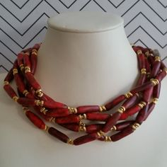 RARE! This highly collectible, beautiful and unique William deLillo statement necklace made from faux red coral and gold-toned beads. I was informed that this necklace is a designer prototype, and I have not been able to find another deLillo necklace in this style! PLEASE NOTE: I priced this piece lower than the going rate of many of deLillos necklaces due to the mismatched bead, which you can see in the 5th image. I believe that bead was placed there during the design of this prototype…