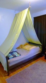 DIY bed tent: maybe canvas stamped with numbers/letters for boys camp room?