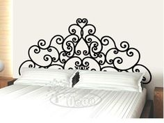 Very cute. Wall decal that looks like a headboard. You can get one made from your local sign shop or order online. There are several on this website.