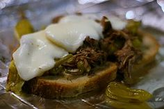 Peperoncini Beef Sandwiches Slow Cooker Recipe - 2 ingredients - cook all day - serve on toasted buns - SUPER EASY!