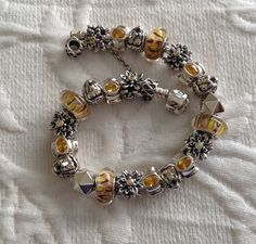 The Pride - love the Pandora retired Lion bead…the detail close-up is spectacular Pandora bracelet by Mary Madigan
