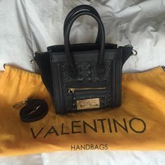 Authentic Valentino Milano ⚫️⚪️ Leidy Mini Satchel in great condition other than 2 small spots at the bottom of interior. Removable strap and dust bag included Valentino Bags