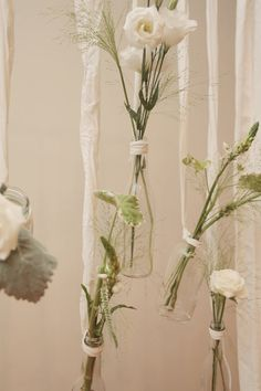 hanging bottles with flowers