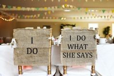 """Burlap & Lace I Do What She Says Wedding Chair Cover Signs. This pair of hand painted burlap """"I Do and I Do What She Says"""" wedding chair cover signs are the perfect rustic wedding addition. Each sign is left open on the sides in order to universally fit most banquet chairs. Includes lace ties for easy attachment. Handmade and Made in America. http://aftcra.com/heartofgolddesign/listing/4363/burlap-lace-i-do-what-she-says-wedding-chair-cover-signs"""