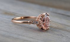 A unique classic style setting with filigree and milgrain etching finishes all wrapped around a 10x8mm Oval Morganite. A very beautiful…