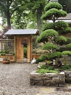 Zen Garden  Use fewer plants for a pared-down Japanese aesthetic.   This entrance features a pagoda-inspired gate, built of reclaimed barnboard and corrugated steel for the roof. A rustic twig lattice fence continues the Asian theme. Pea gravel and bonsai-type trees are reminiscent of an authentic zen garden and require minimal upkeep.