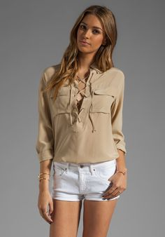 """Equipment's """"Knox"""" 100% silk blouse in dune ($228) - lace up front tie closure; front flap pockets; button-cuffed sleeves. Dry clean only."""