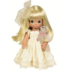 This blonde Precious Moments doll is dressed in a pretty ivory and lace gown and carries her own mini plush teddy bear. Description from flossiesgifts.com. I searched for this on bing.com/images