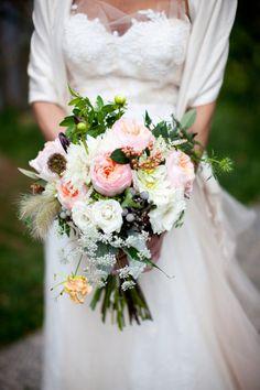 Bridal bouquet with garden roses, berries, dahlias, Queen Anne's lace.