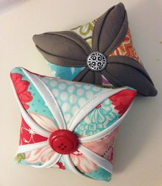 Cathedral window pin cushion {tutorial}. I think this would make a beautiful throw pillow too~