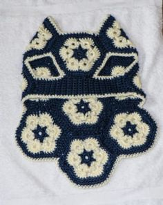 Ravelry: African Flower Dog Sweater pattern by Melissa Hollenbeck Crochet Dog Clothes, Crochet Dog Sweater, Dog Sweater Pattern, Pet Clothes, Crochet Pet, Dog Clothing, Dachshund Sweater, Crochet African Flowers, Dog Jumpers